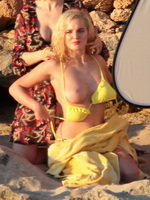 Helen Flanagan stripping her skimpy yellow bikini during photoshoot at the beach in Ibiza from CelebMatrix