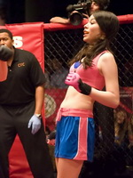 Miranda Cosgrove wearing sports bra and shorts boxing with Victoria Justice on the iCarly set from CelebMatrix