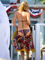 Paris Hilton shows off her hot body wearing tiny striped bikini at the beach in Malibu from CelebMatrix