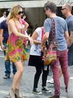 Kate Hudson braless wearing colorful bare back mini dress out in Rome from CelebMatrix