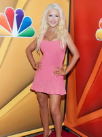 Christina Aguilera showing huge cleavage in a tight pink mini dress at 2013 Summer TCA Tour in Beverly Hills from CelebMatrix