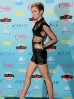 Miley Cyrus wearing black leather bra and mikro skirt at 2013 Teen Choice awards in Universal City from CelebMatrix