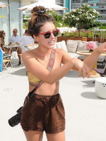 Shenae Grimes wearing golden bikini top and shorts at the Waikiki Edition Opening Weekend celebration in Hawaii from CelebMatrix