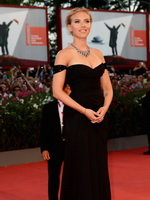 Scarlett Johansson braless wearing black strapless maxi dress at Under The Skin screening on 70th Venice Film Festival from CelebMatrix