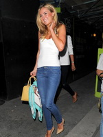 Kimberley Garner wearing tiny white top and tight jeans for Genes Party in London from CelebMatrix