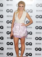 Pixie Lott wearing white low cut mini dress at GQ Men of the Year Awards in London from CelebMatrix