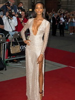 Jourdan Dunn braless wearing low cut and high slit partially see-through dress at GQ Men of the Year Awards in London from CelebMatrix
