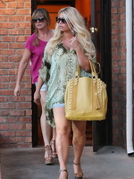 Jessica Simpson cleavy and leggy wearing snake print shirt and denim shorts out in Calabasas from CelebMatrix