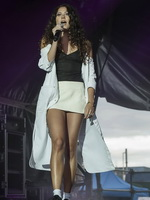 Eliza Doolittle upskirt wearing white mini skirt and tiny black top at the concert in Blackpool from CelebMatrix