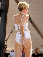 Miley Cyrus showing off her hot body in a tiny white outfit at iHeart Radio Music Festival Village in Las Vegas from Celebs Dungeon