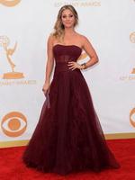 Kaley Cuoco braless wearing gorgeous red strapless dress at 65th Annual Primetime Emmy Awards in Los Angeles from Celebs Dungeon