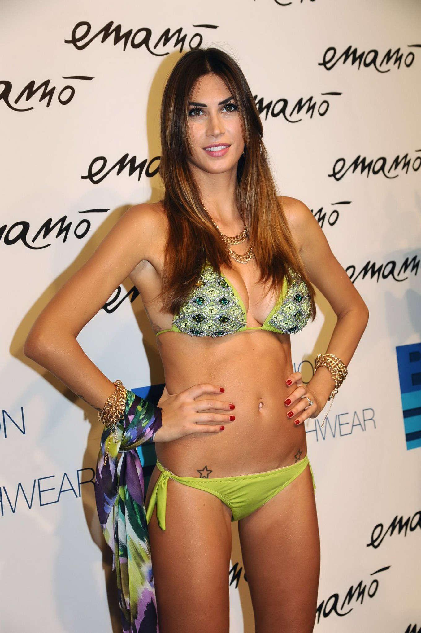 melissa satta showing off her hot bikini body at the emamo fashion