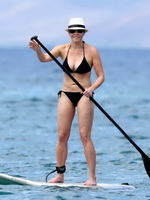 Chelsea Handler busty wearing black string bikini at the beach in Hawaii from CelebMatrix