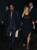 Kim Kardashian caught see-through to bra while leaving Givenchy Fashion Show in Paris from CelebMatrix