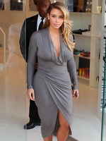 Kim Kardashian showing big cleavage in a high slit gray dress outside Dash boutique and LA opera from Celebs Dungeon