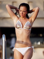 Tulisa Contostavlos wearing tiny white sparkling bikini at the beach in Dubai from CelebMatrix