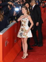 Scarlett Johansson busty and leggy wearing floral mini dress at Her premiere in Rome from CelebMatrix