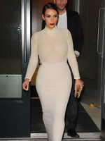 Kim Kardashian wearing tight white see-through dress in downtown Manhattan from CelebMatrix