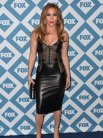 Jennifer Lopez braless wearing black partially see-thru leather  lace dress at 2014 Fox All-Star Party in Pasadena from CelebMatrix