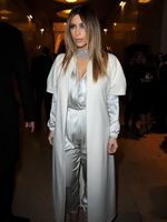 Kim Kardashian cleavy wearing low cut white satin gown at Stephane Rolland's fashion show in Paris from CelebMatrix