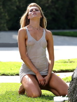 Maryna Linchuk hot boob-slip during some wet T-shirt photoshoot at the park in Los Angeles from CelebMatrix