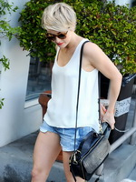 Julianne Hough caught in tiny denim shorts and white top while leaving Cuvee in Los Angeles from CelebMatrix