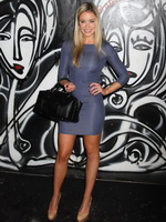 Katrina Bowden wearing tight blue polka-dot mini dress during Mercedes-Benz Fashion Week in NYC from Celebs Dungeon