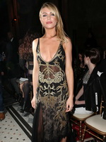 Abigail Clancy nipple-slip in a low cut partially see-through dress at Julien Macdonald's London Fashion Week from CelebMatrix