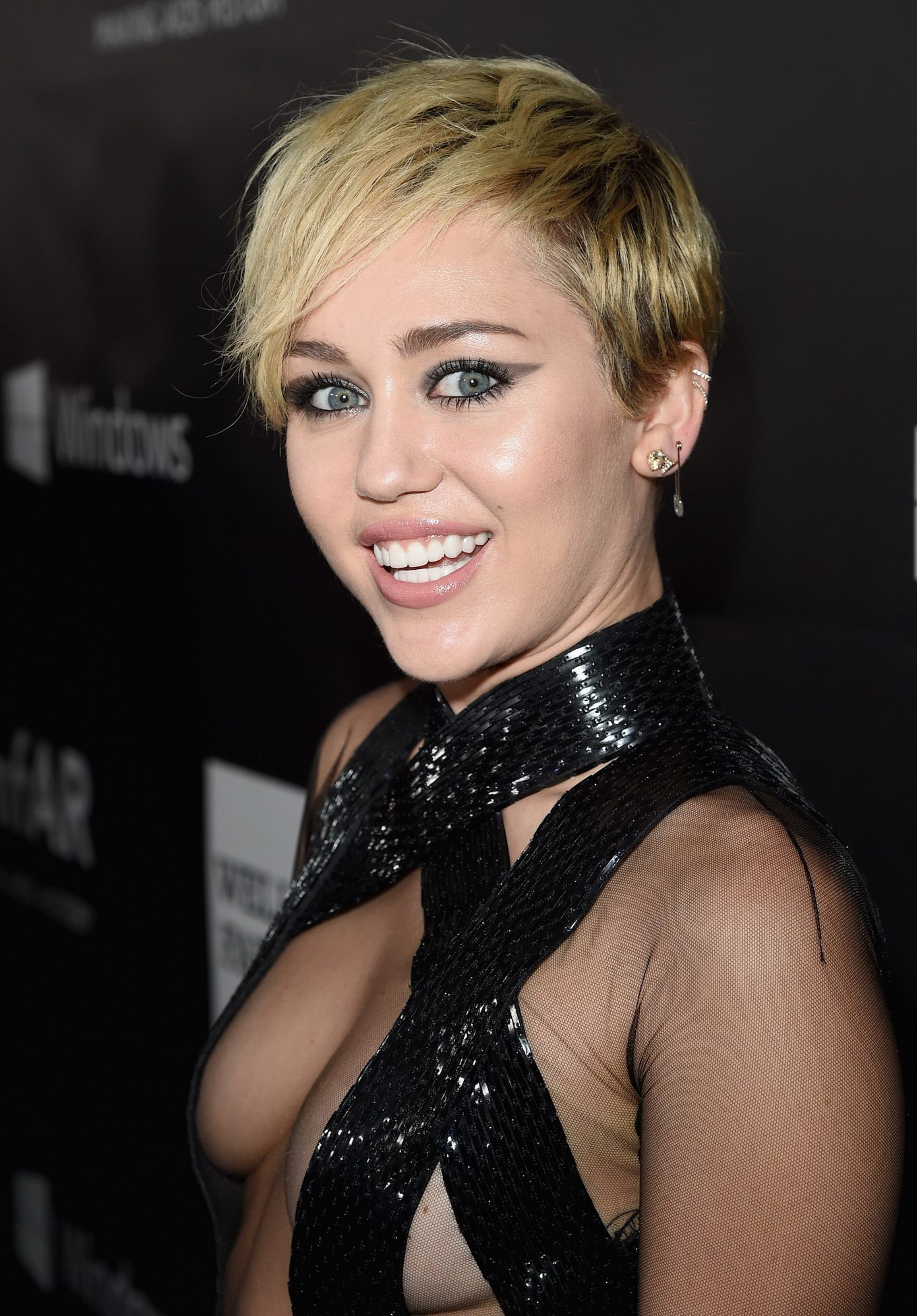 Miley Cyrus Braless In Black See-through Dress At AmfAR LA