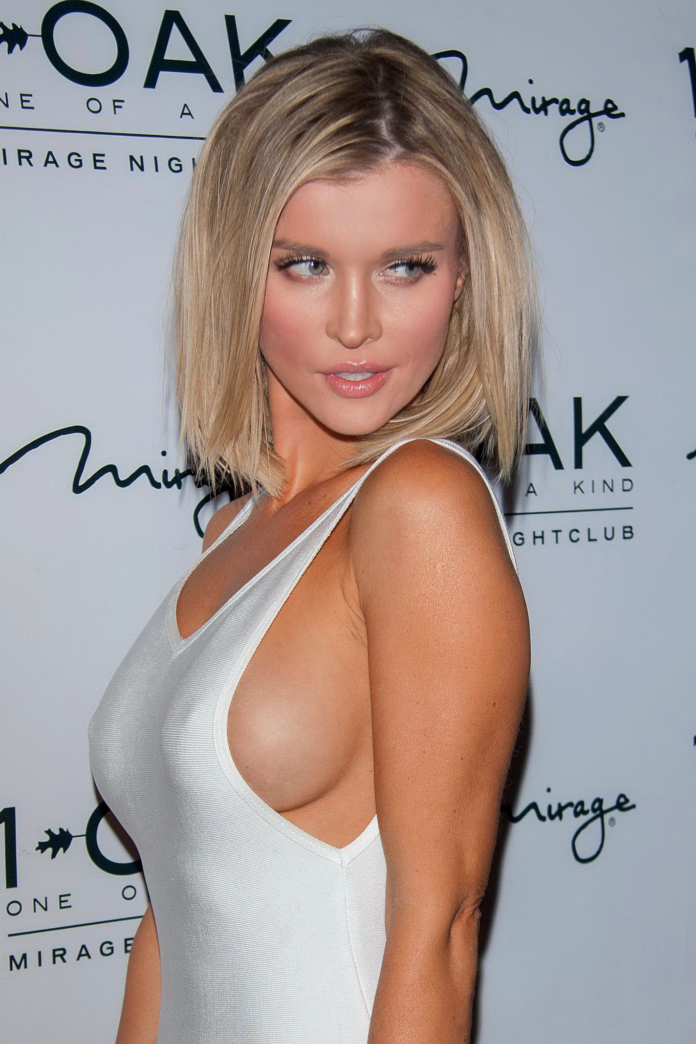 Joanna Krupa braless showing side-boob and pokies in a ...