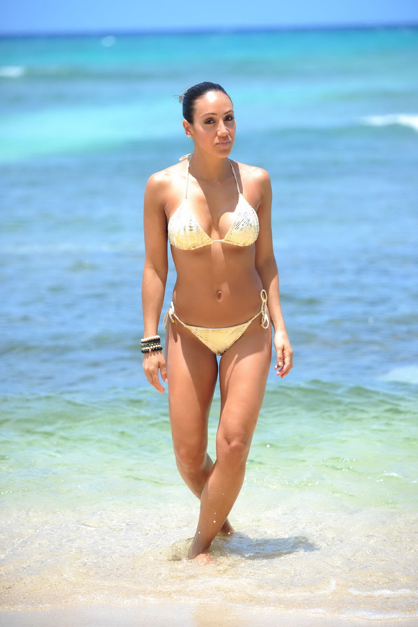 gorga wearing skimpy golden string bikini at the vacation in jamaica