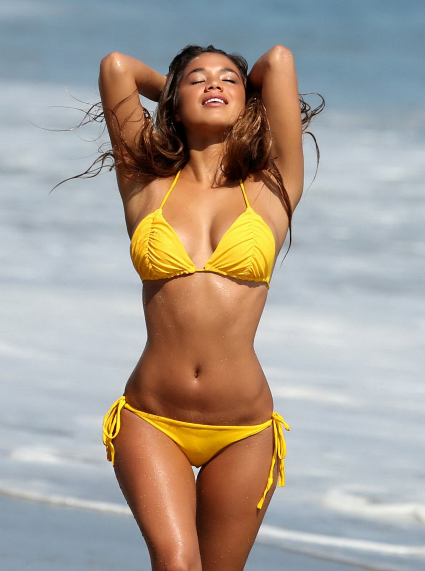 eryn krouse wearing tiny yellow bikini at the beach for 138 water