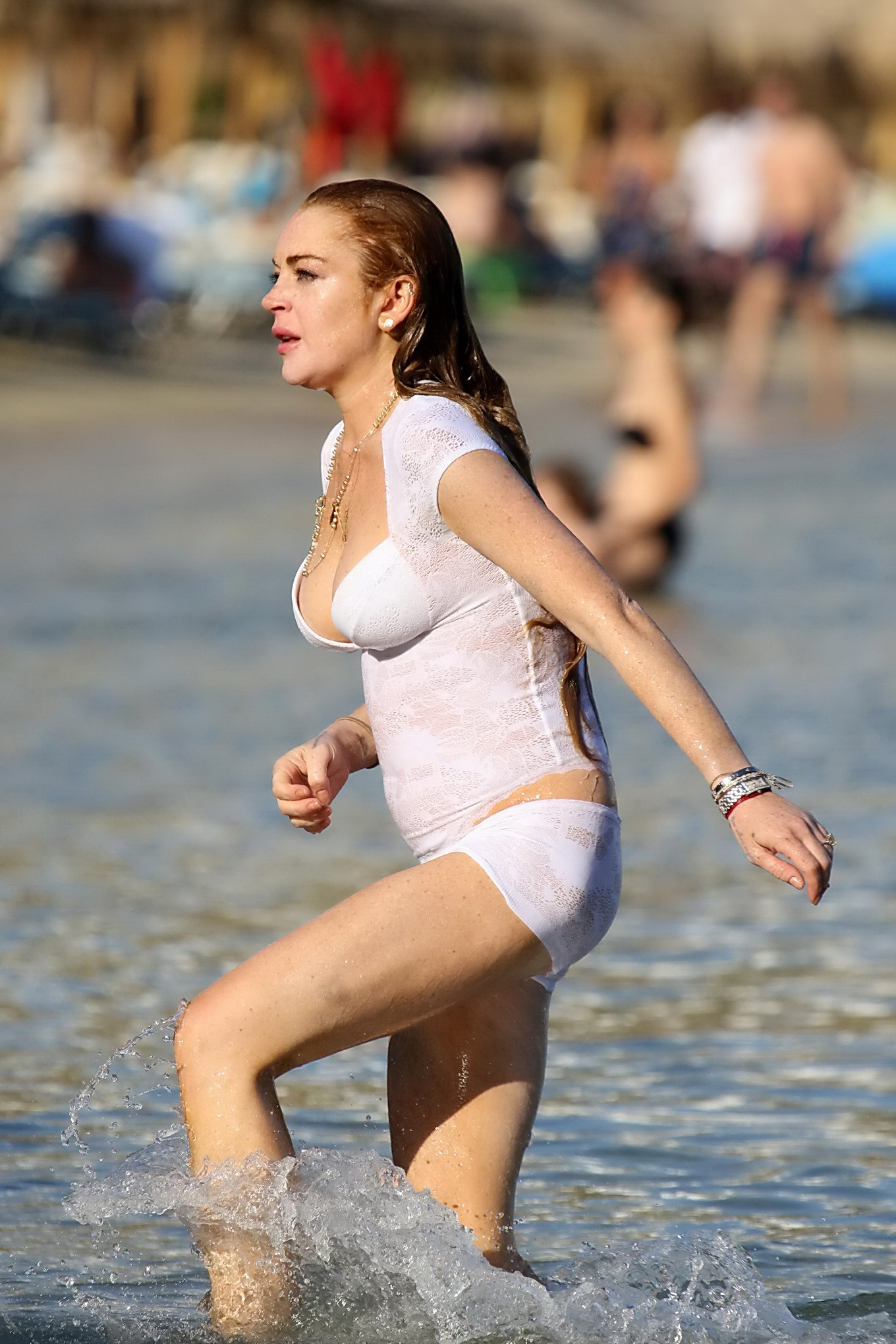lindsay lohan busty wearing  arre white transparent swimsuit at the