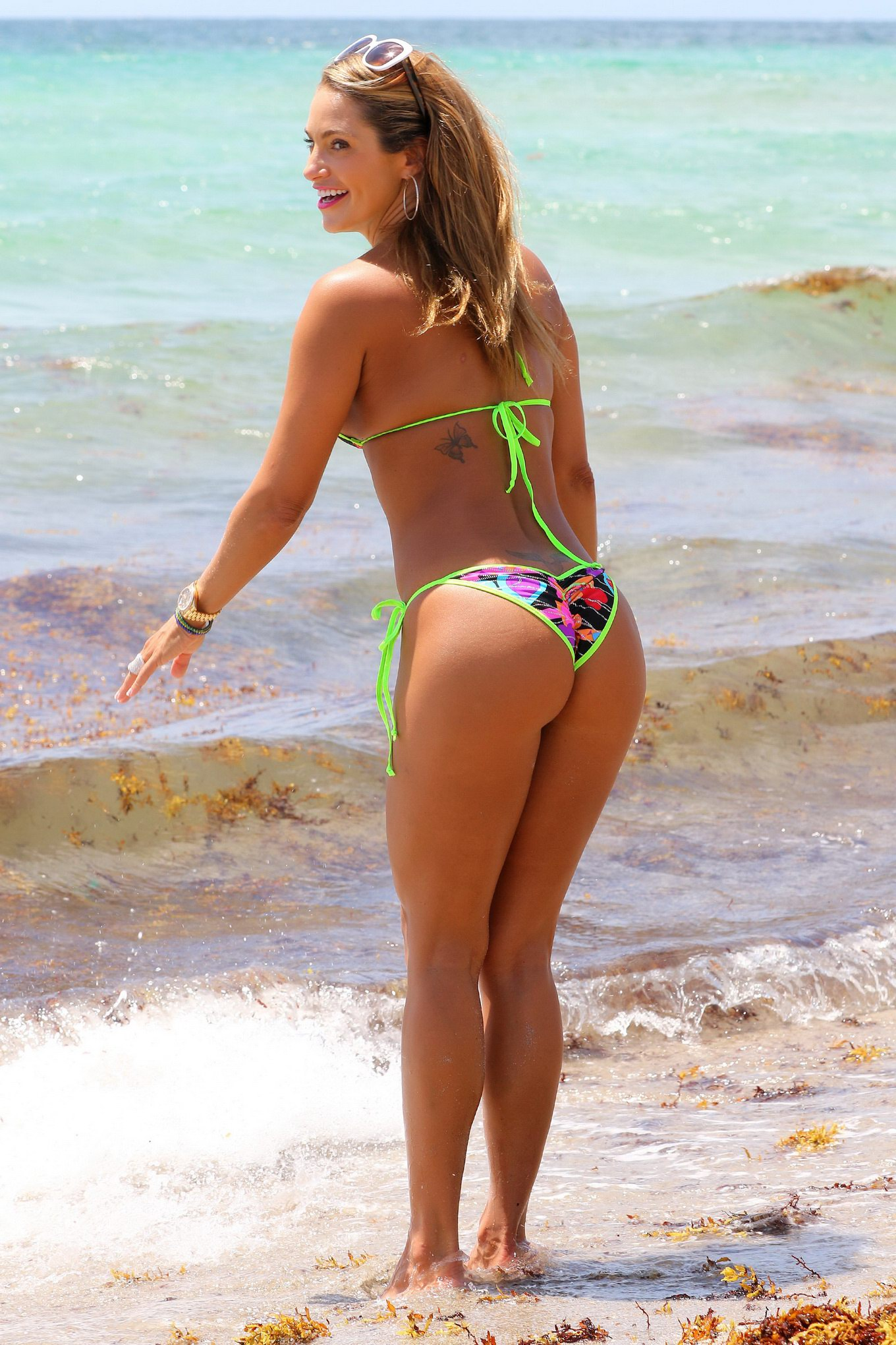 jennifer nicole lee tiny colorful bikini malfunction at the beach in