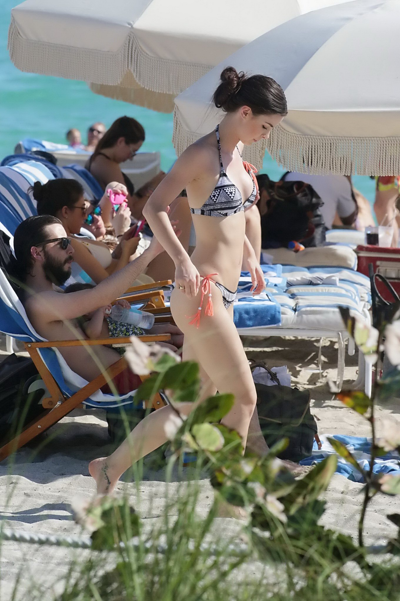 off her hot body in skimpy monochrome bikini at the beach in miami
