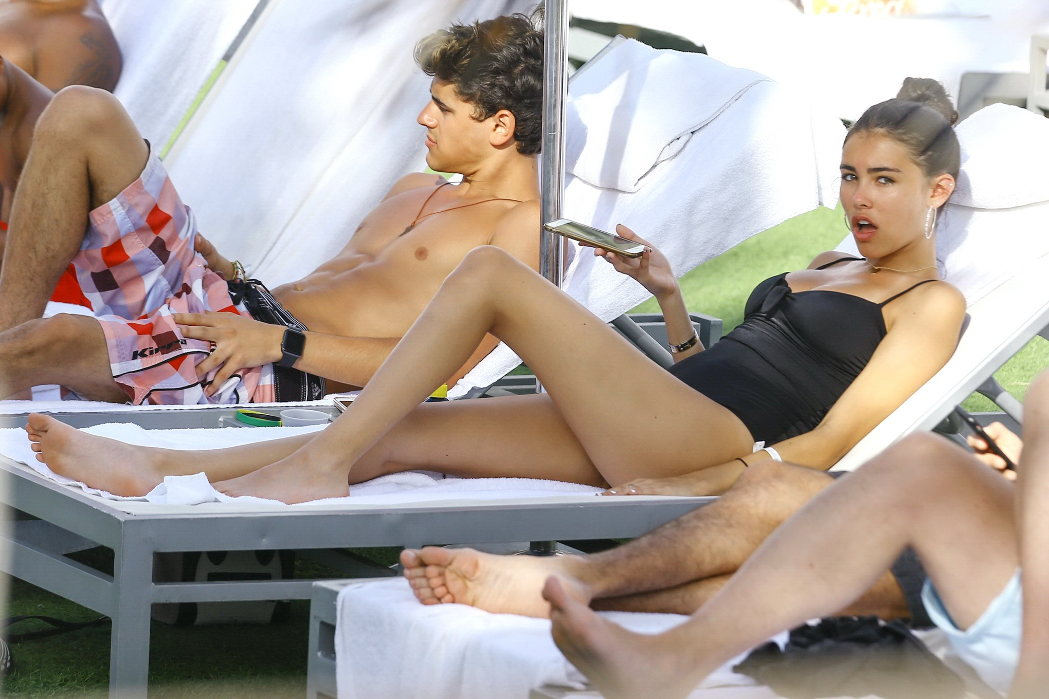 Madison Beer showing off her hot body in black swimsuit at the beach in Miami