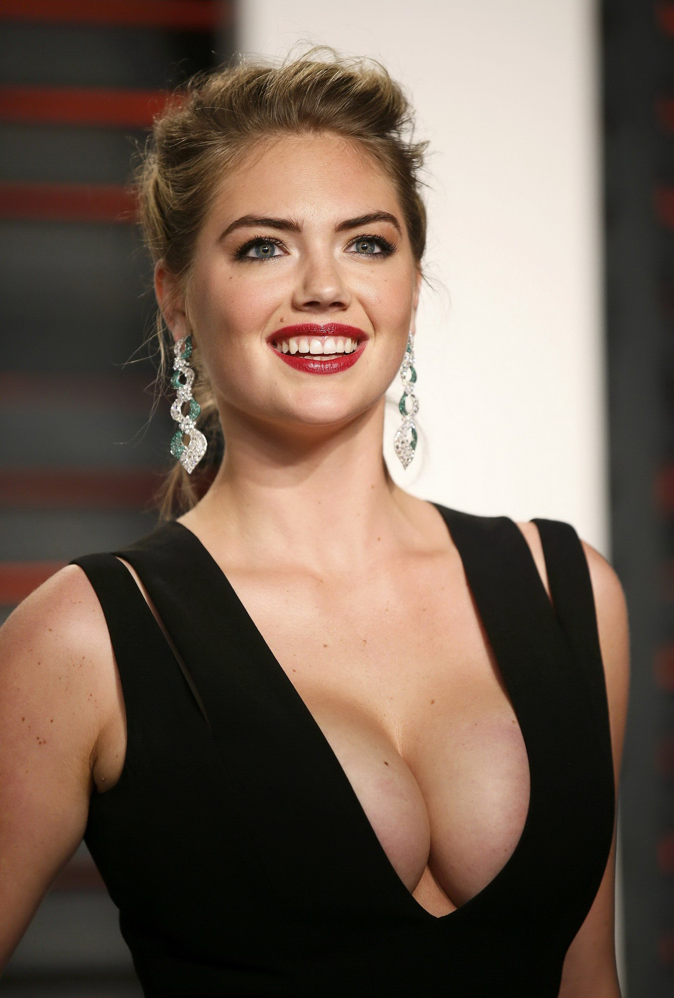 kate upton flaunting her huge boobs in a low cut black dress at the