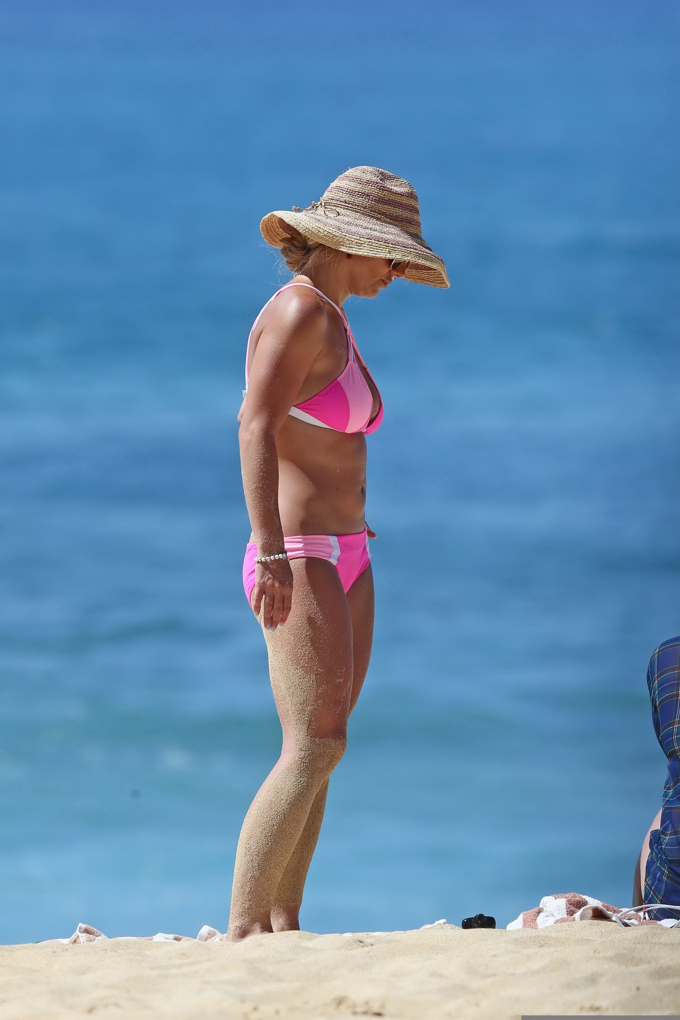 Britney Spears exposing her curvy body in a tiny pink bikini at the ...