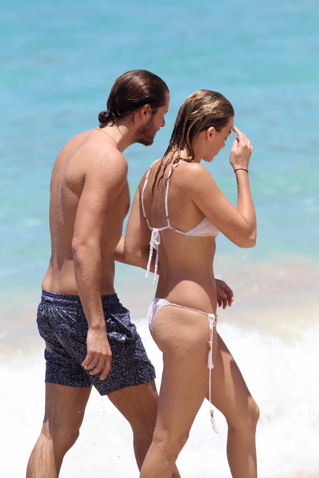 off her hot body in tiny white knitted bikini at the beach in st barts
