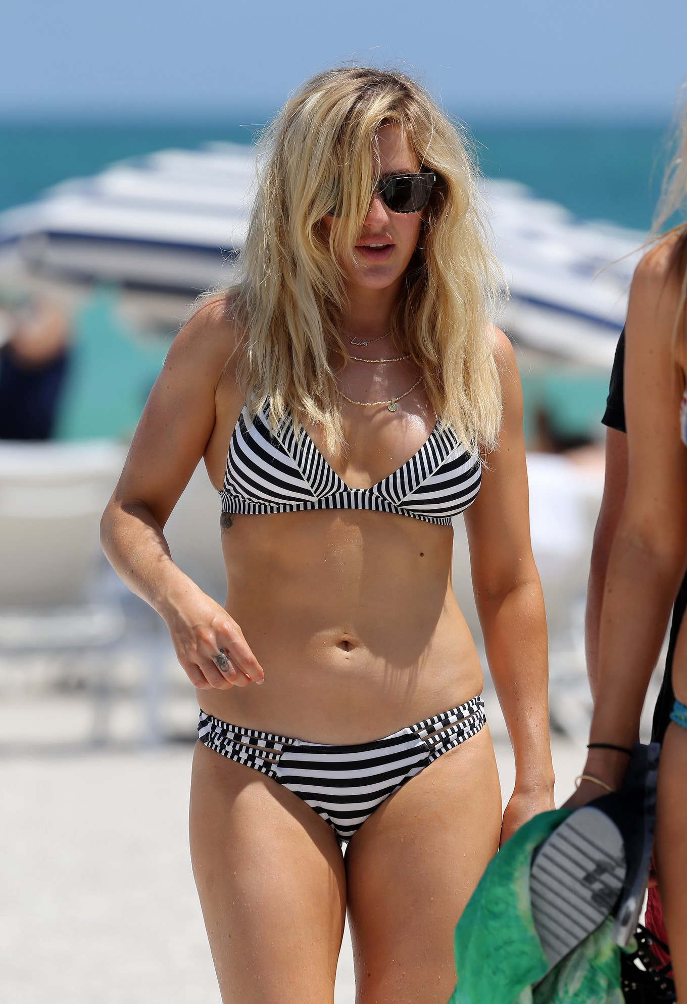her hot body in a monochrome striped bikini at the beach in miami