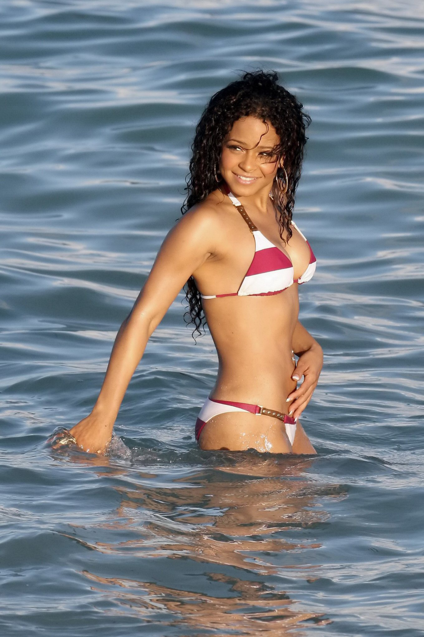 her hot body in tiny bi colored bikini at the beach in miami