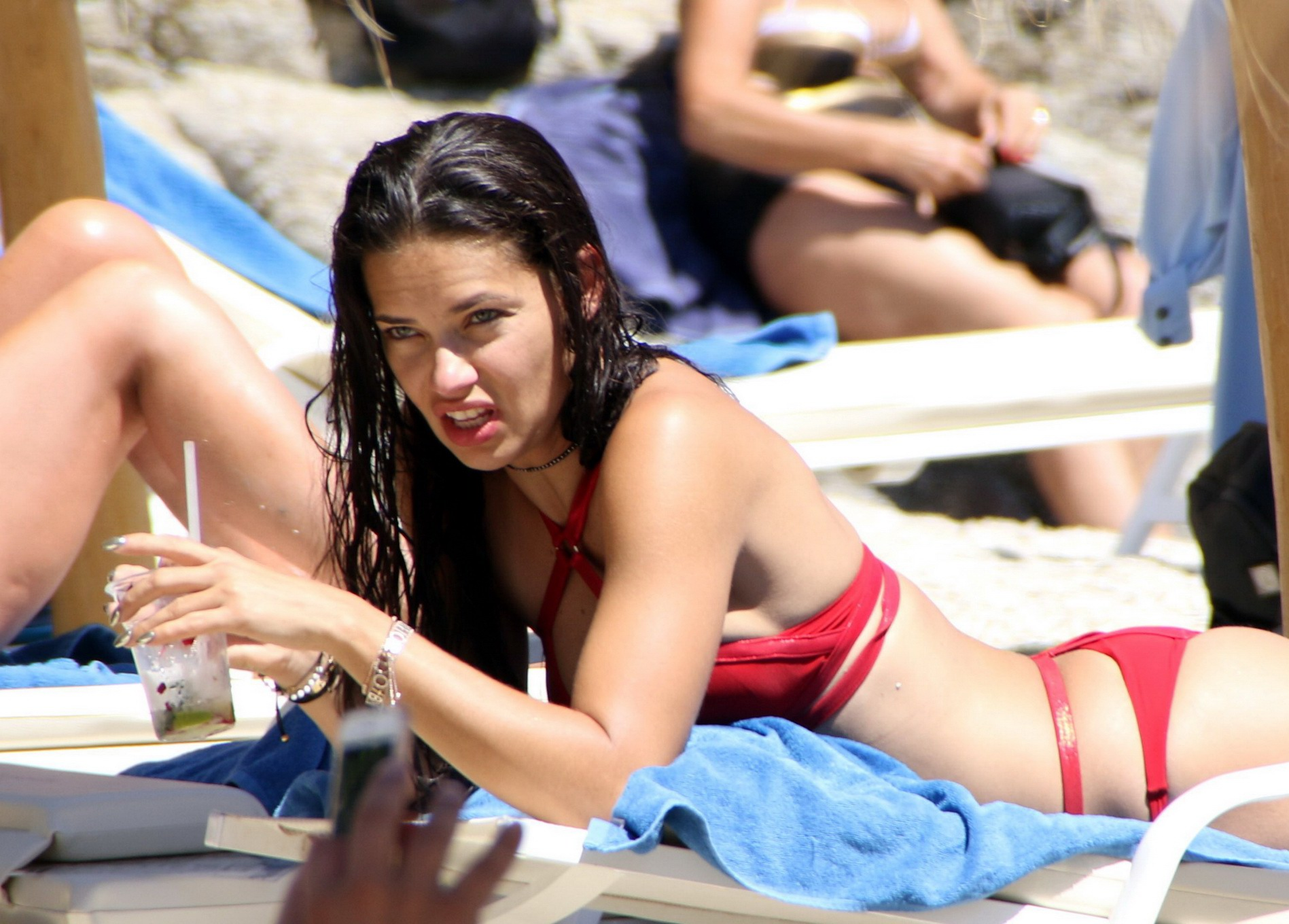 displaying her hot body in a tiny red bikini at the beach in mykonos