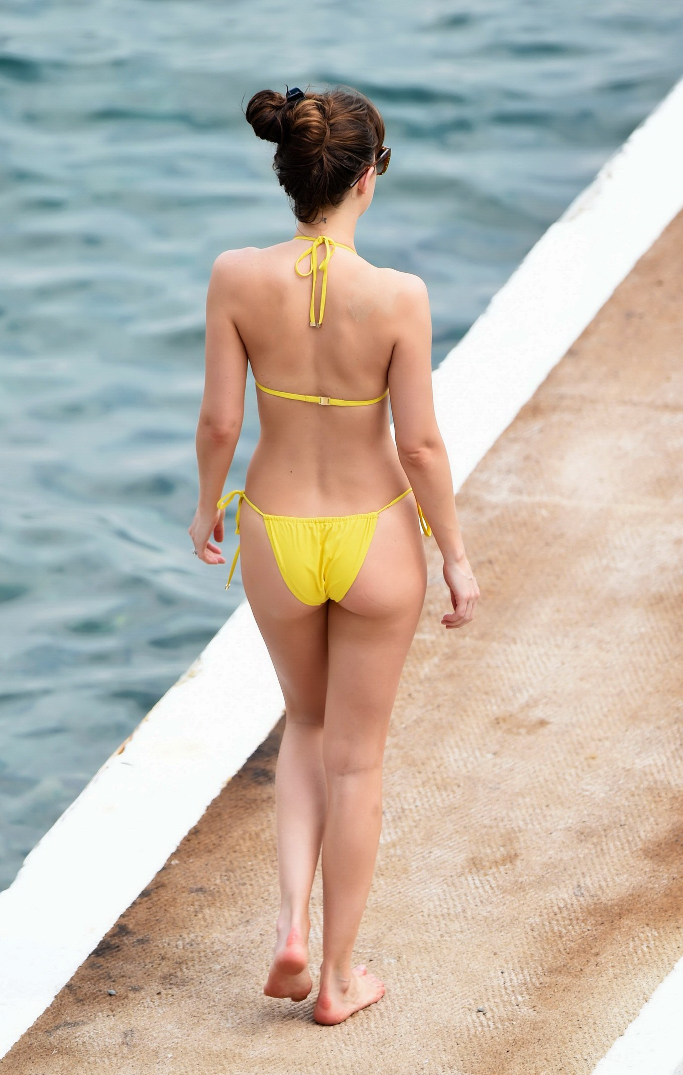 off her hot body in a wet sheer yellow bikini at the beach in france