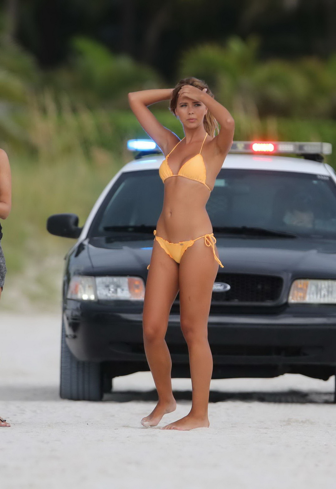 off her hot body in a tiny orange string bikini at the beach in miami