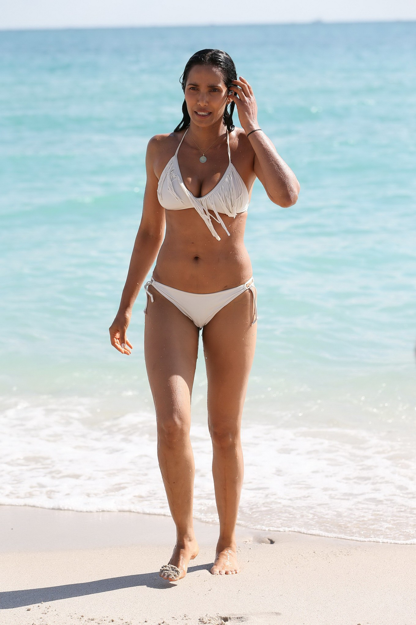 displaying her hot body in a skimpy white bikini at the beach in miami