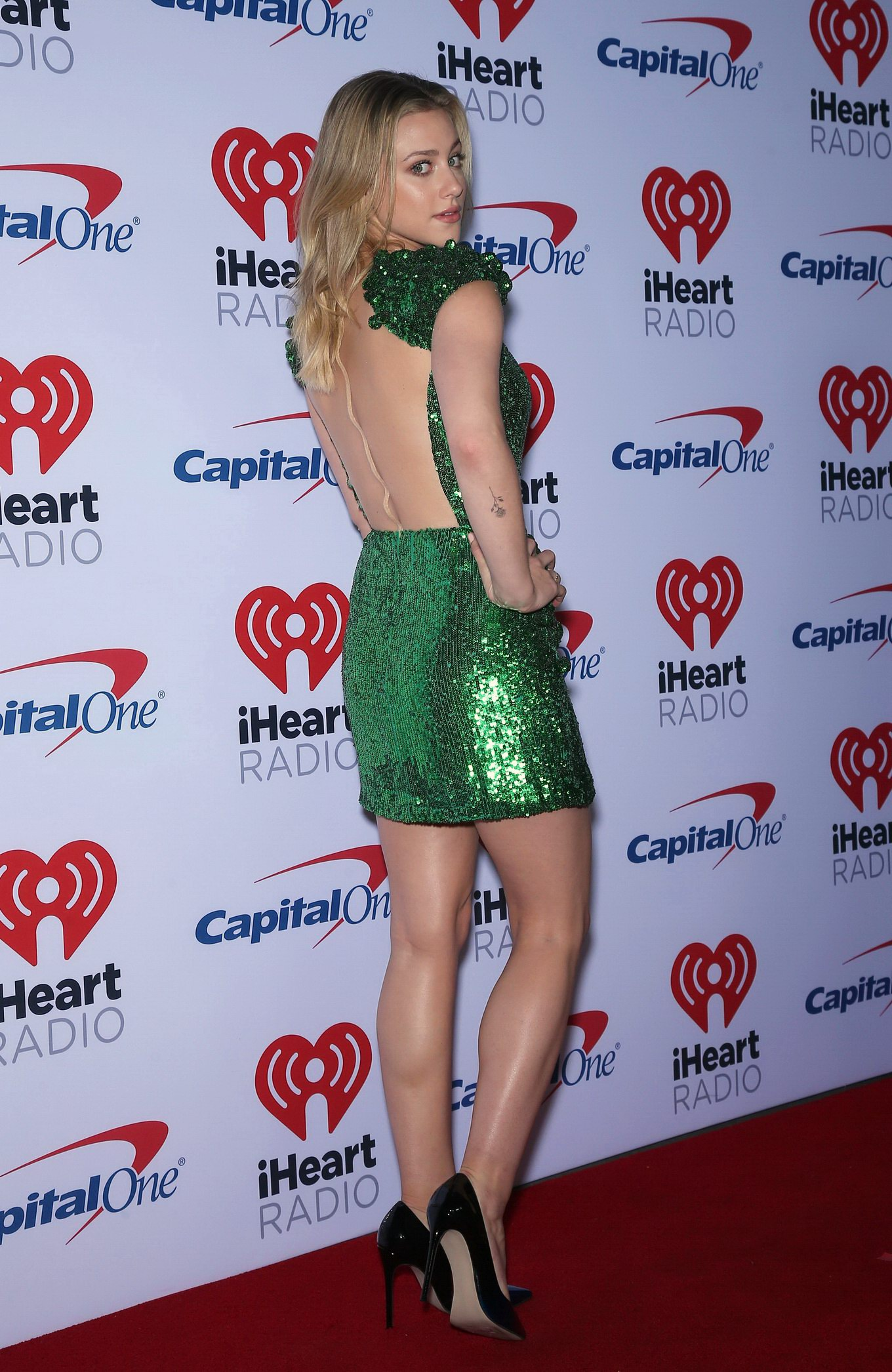 lili reinhart braless in a plunging green mini dress at