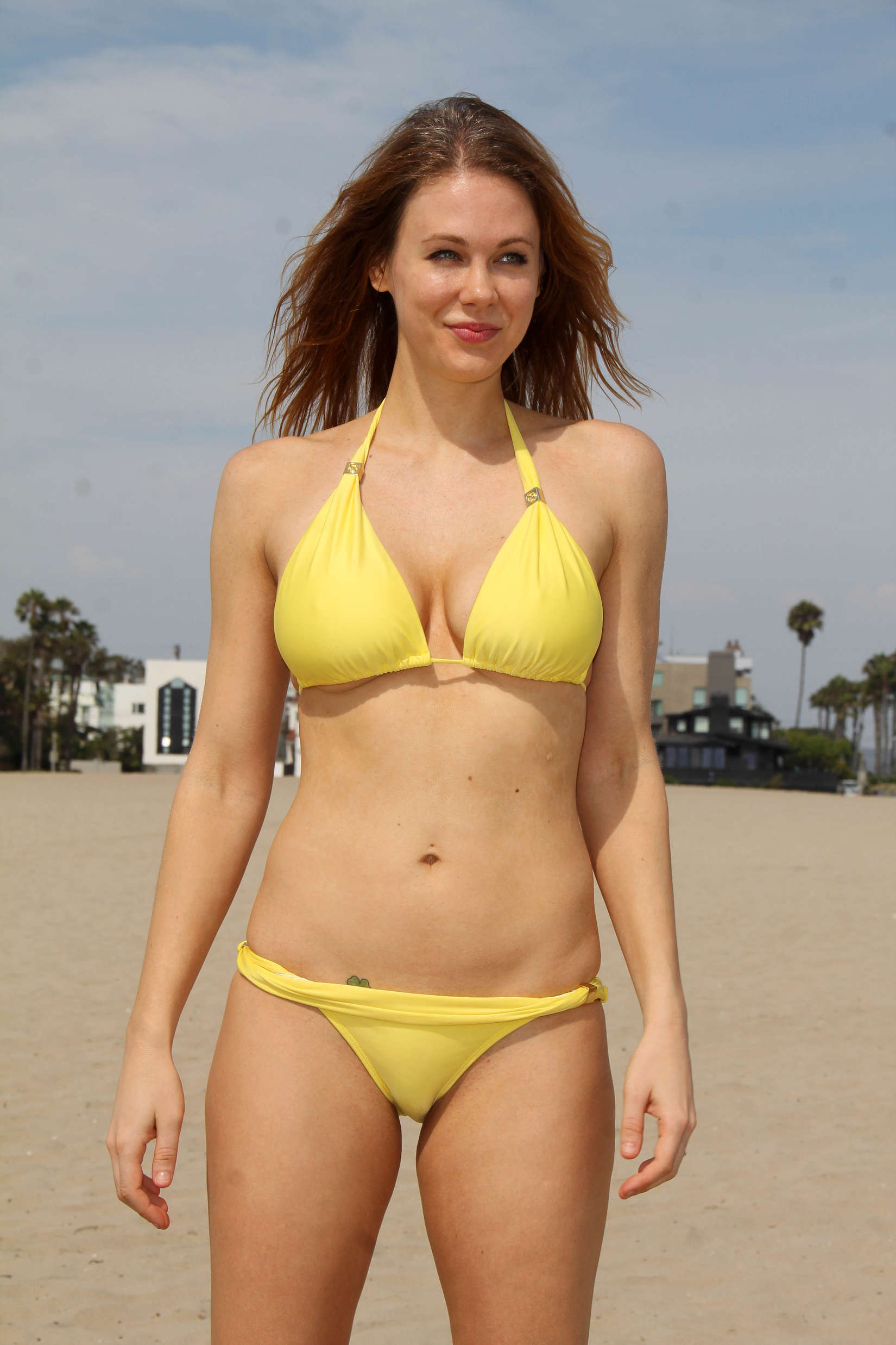 Maitland Ward exposing her hot body in a skimpy yellow ...