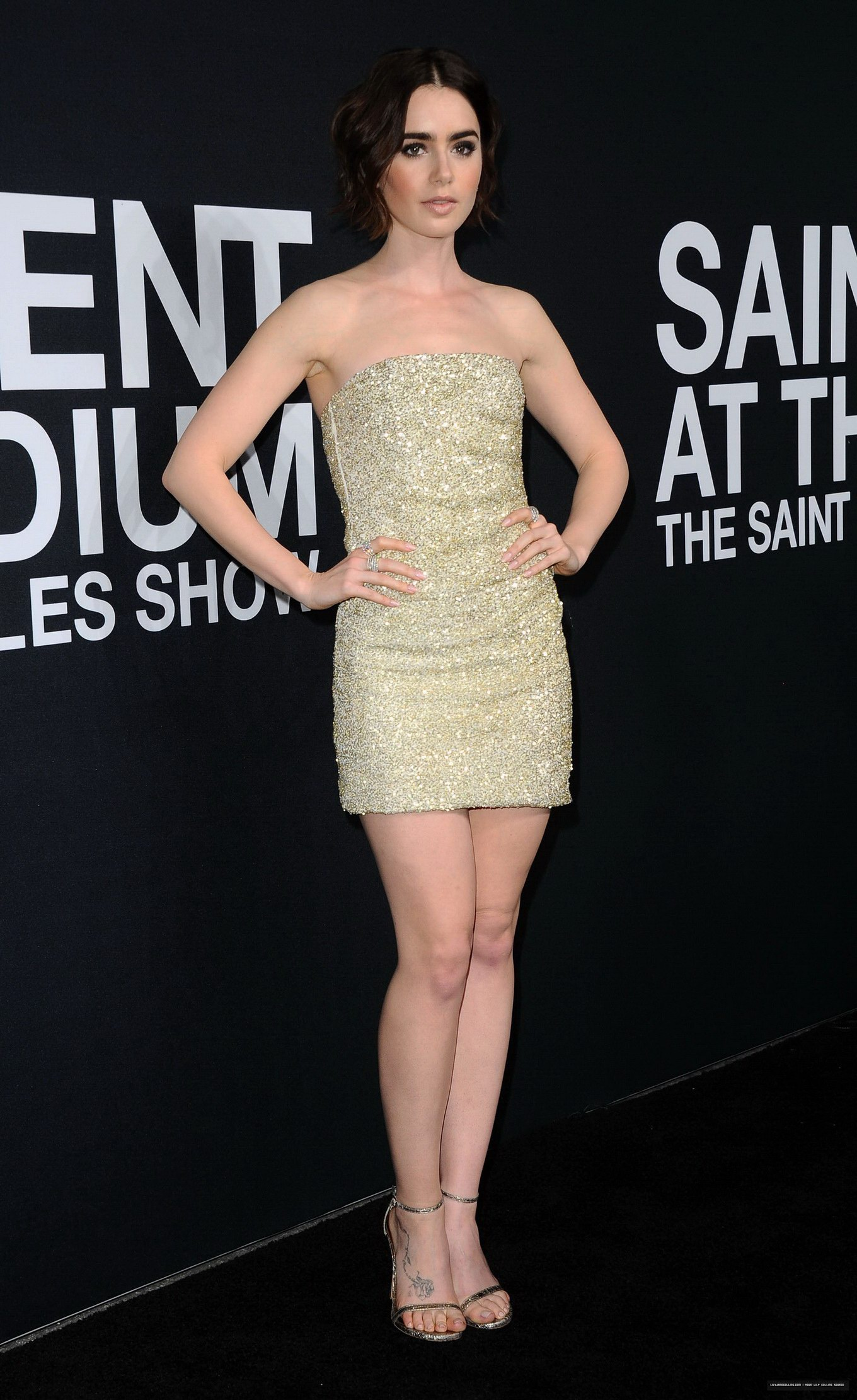 Lily Collins looks hot in a shiny tube mini dress for ...