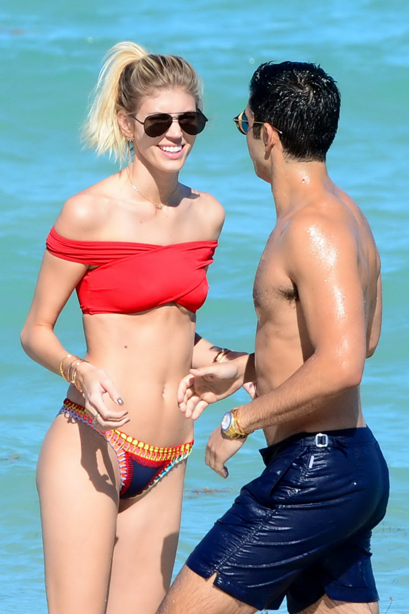 Devon Windsor showing ass in a tiny two-piece bikini at ...