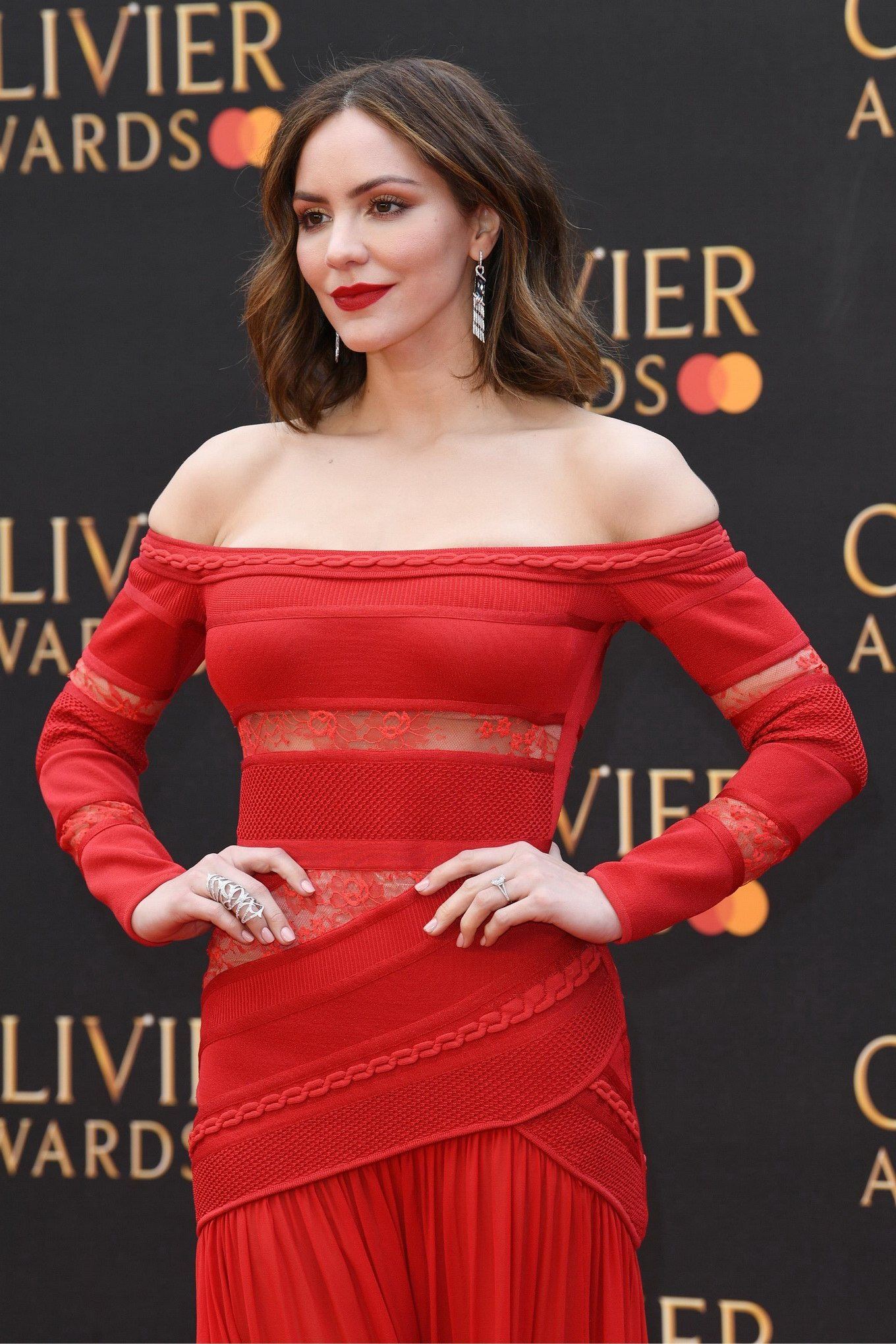 Katharine McPhee busty in a red strapless partially see ...